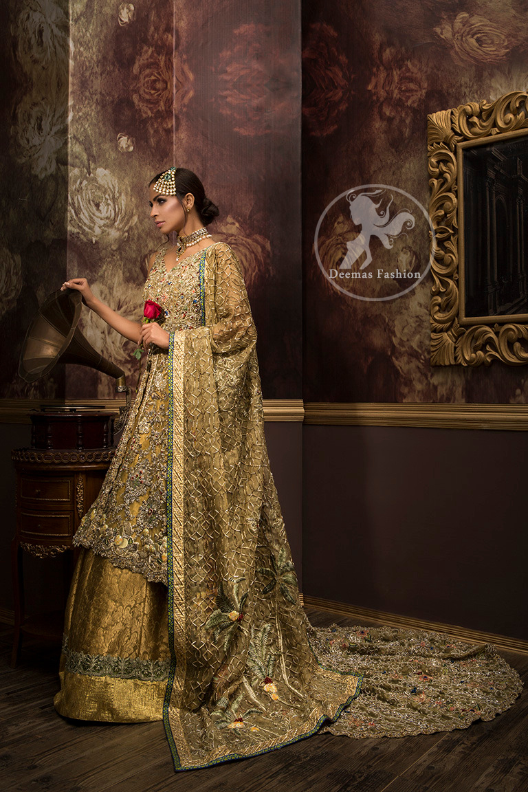Golden organza lehengha comes with pure crinkle chiffon dupatta having heavy embroidery. Dress comes with front open long back trail gown.