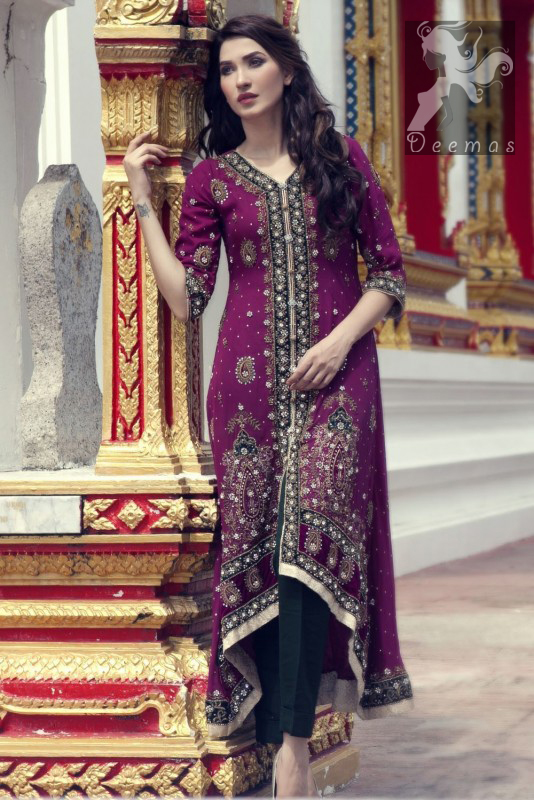 Dark purple front open back train gown. Gown having navy blue applique with silver embellishment. It comes with Navy blue churidar trousers and chiffon dupatta.