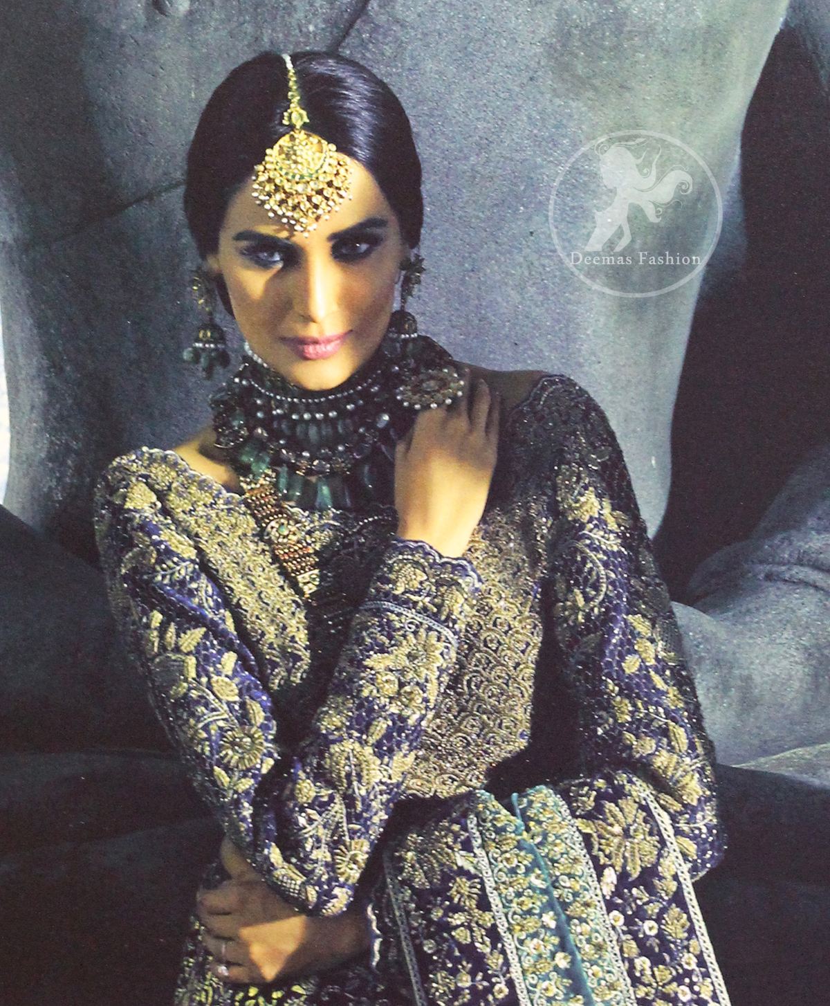 Violet Blue Blouse is of velvet fabric. It is heavy embellished ful sleeves blouse featuring antique and golden shaded kora, dabka, resham, naqshi, pearls, crystals and swarovski. Blouse is fully scalloped with blue bayoux resham outline. sleeves are adorned with floral work and sprinkling sequins/naqshi on it, while bodice having crossing heavy pattern all over it. It comes with raw silk lehengha which is adorned with block printing. It is artistically coordinated with blue bayoux dupatta which is adorned with fully embellished appliqued borders. Borders are accompnied by delicate work along its internal sides. There are four embellished heavy flowers on corners and small floral pattern all over it.