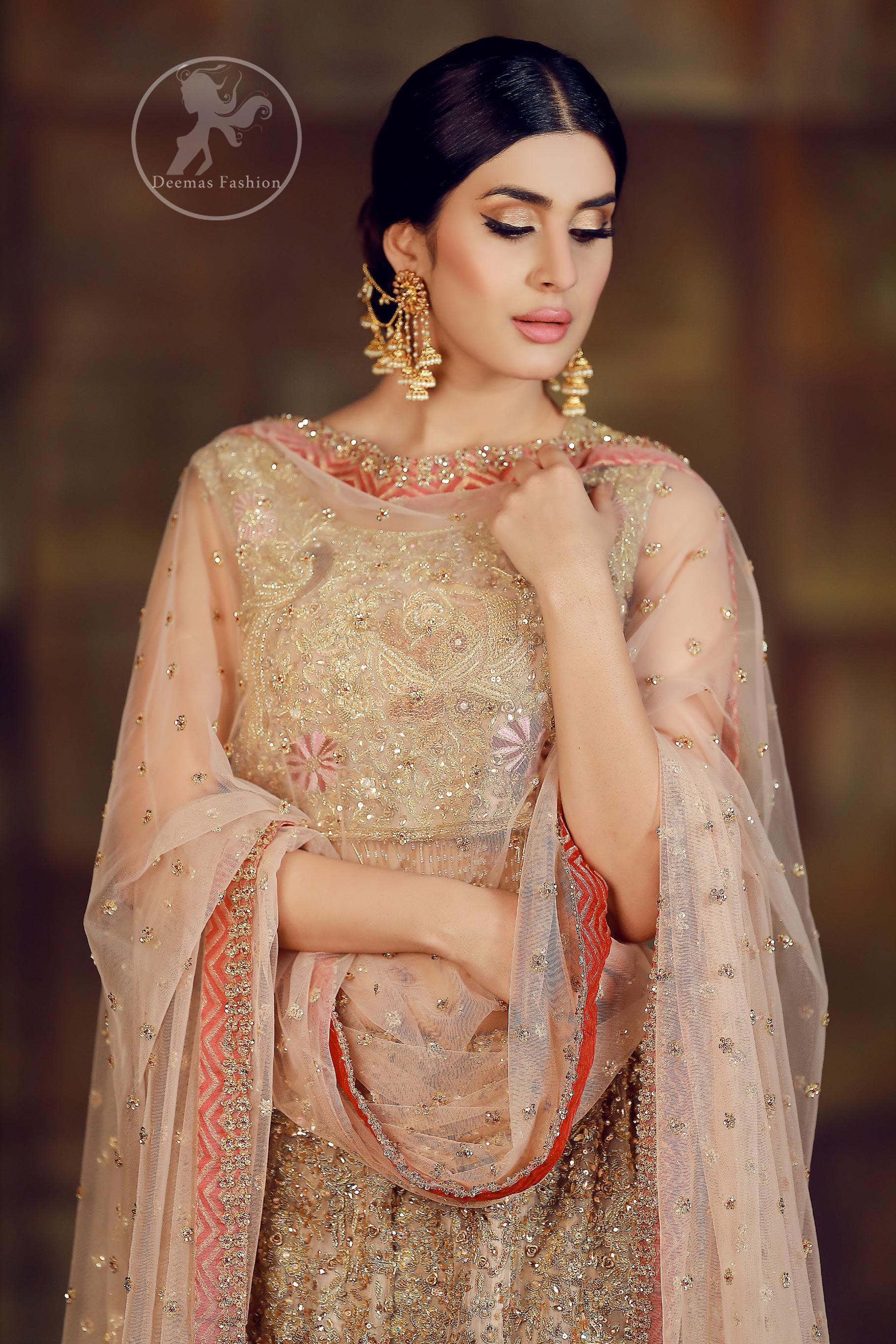 This dress is beautifully sculptured with floral thread embroidery. Blouse is fully embellished and decorated with tassels. Lehengha is embellished with different shaded thread embroidery, allured with kora, dabka, tilla, sequins and pearls.