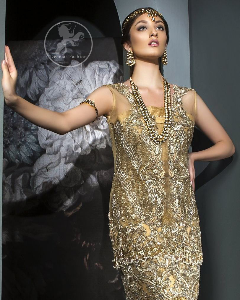This dress is beautifully sculptured with floral embroidery. It is meticulously highlighted with antique shaded kora, dabka, tilla, sequins and pearls. It is allured with beautiful tassels which adds to the look. It is beautifully paired up with embroidered brocade sharara. It comes with organza/tissue dupatta which has four sided embellished border and applique.