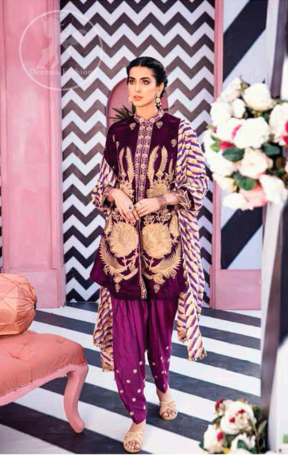 This outfit is a timeless beauty. It is embellished with golden kora, dabka, tilla and kundan. This shirt is fully decorated with floral motifs all over it. Round collar neckline ornamented with small sized floral patterns. It is further enhanced with golden floral thread embroidery. It comes with magenta shalwar which has small sized sprinkled floral motifs all over. This Outfit is beautifully coordinated with multiple colored lining dupatta.