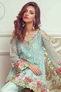 This outstanding self embroidered short frock embellished with floral thread embroidery. It is allured with resham kora dabka tilla and pearls. Sleeves are decorated with cold shoulders design and floral embroidery. Scalloped hemline ornamented with tassels. It is beautifully paired up with matching bell bottom trouser. It comes with light blue dupatta sprinkled with sequins all over it.