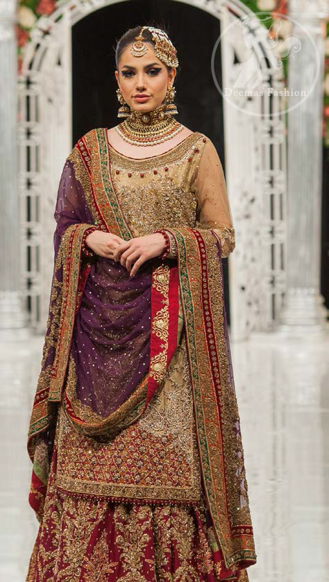 This bridal dress is perfect for your special day. Exude elegance in this chiffon shirt finessed with beautiful embellished daman and neckline, done with antique shaded kora dabka, tilla, sequins and pearls. Lehenga comprises of floral embroidery adorned with thick embellished border. It comes with purple dupatta with embroidered borders on all sides and sequins spray on the ground.