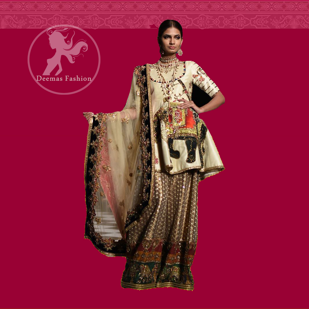 This signature angrakha is crafted with raw silk featuring hand embroidery with elegant zardoze work. The sharara with it is made of brocade with applique detail on bottom done with kora dabka, kundan and tilla work. It comes with ivory dupatta adorned with black applique and heavy embellished borders on all sides.