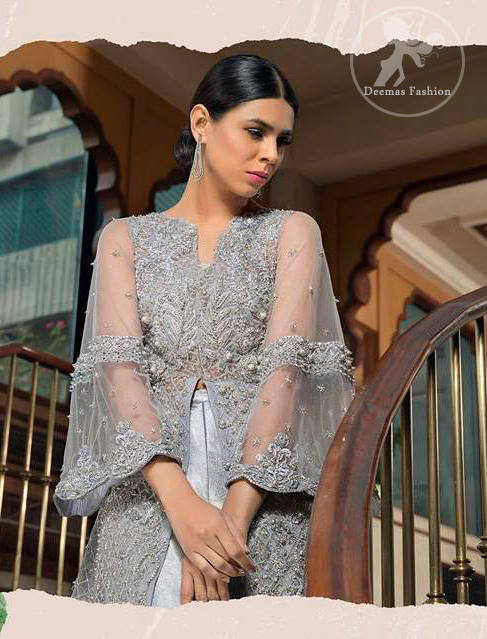 This dress is timeless beauty. Light gray, dress with heavy embellishment with swarovski crystals and silver work in sequins, kundan and kora dabka. The back trail is allured with intricate embroidered patterns and floral motifs. It is finished with light gray sharara.