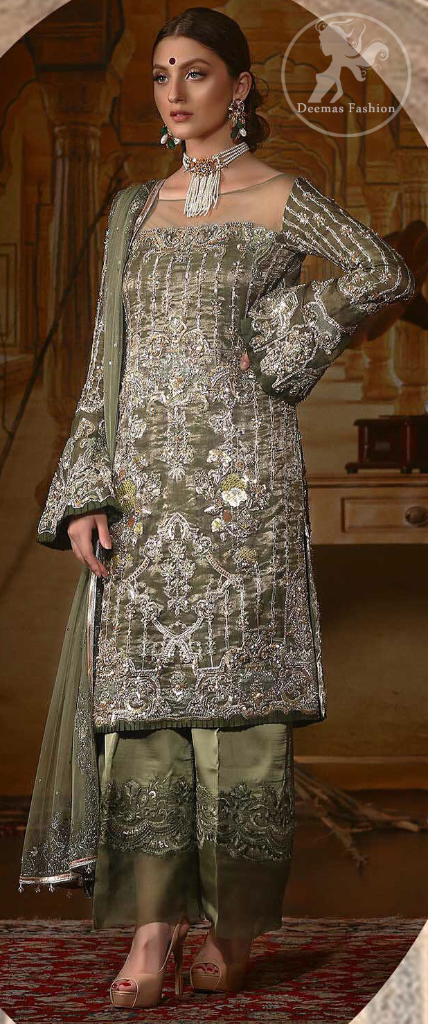 The beautiful bodice is decorated with intricate stones and sequins. It is further enhanced with vertical lines and floral motifs done with kora dabka, tilla, sequins and colorful thread work. Paired up with embroidered bell bottom. This outfit is beautifully coordinated with olive green dupatta with embellished borders on sides and sprinkled sequins.