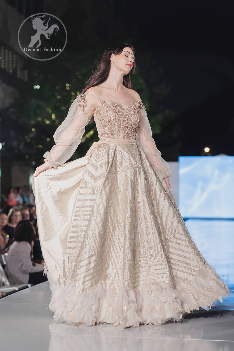 This dress is timeless beauty. The sweetheart neckline is decorated with intricate stones and sequins. Antique shaded kora dabka enhanced the beauty of bodice. Off shoulder sleeves enhanced the beauty of this maxi. Waist belt add to the look. It is paired up with antique white churidar pajama.