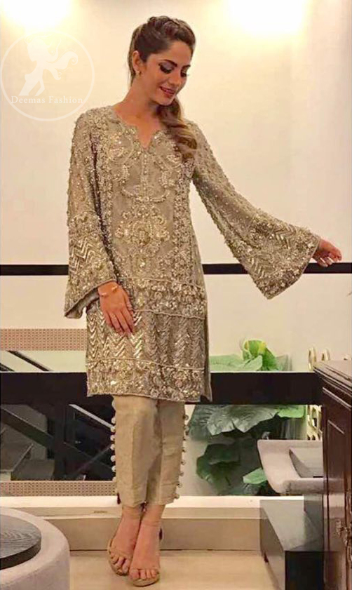 This dress is beautifully sculptured with floral embroidery. It is allured with kora, dabka, tilla, sequins and pearls. Bell shaped sleeves adds to the look. It comes with pants which is allured with buttons. It is coordinated with chiffon dupatta, sprinkled with sequins all over it.