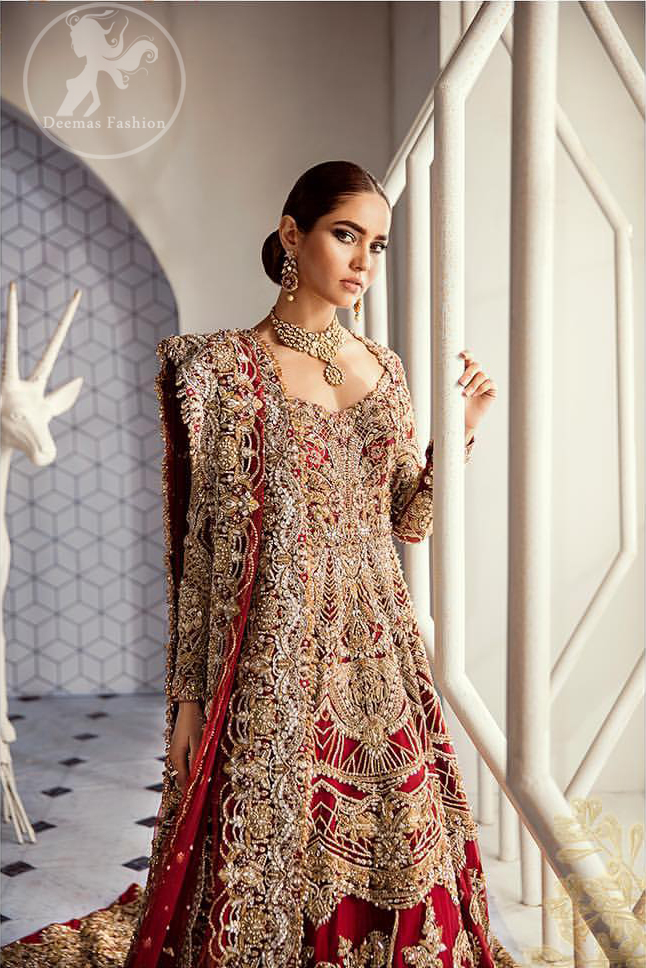 Look alluring in this floor length frock embellished with kora dabka, tilla, swarovsky and pearls. It has intricate embroidered motifs and detailed bodice. The border on the daman is enhanced with embellished floral pattern detailing that instantly draws attention. Heavy back trail frock adds to the look. It comes with matching pajama. It is paired up with heavy embroidered dupatta.