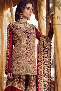 The bridal stands out due to its uniqueness and the perfect fusion of modern cut and traditional embroidery. This dress is beautifully decorated with heavy embroidery. It is highlighted with kora, dabka, tilla, sequins and pearls. It comes with heavy embroidered gharara. It is coordinated with chiffon dupatta which is sprinkled with sequins all over it. It is allured with four sided embellished borderand beautiful tassels adds to the look.