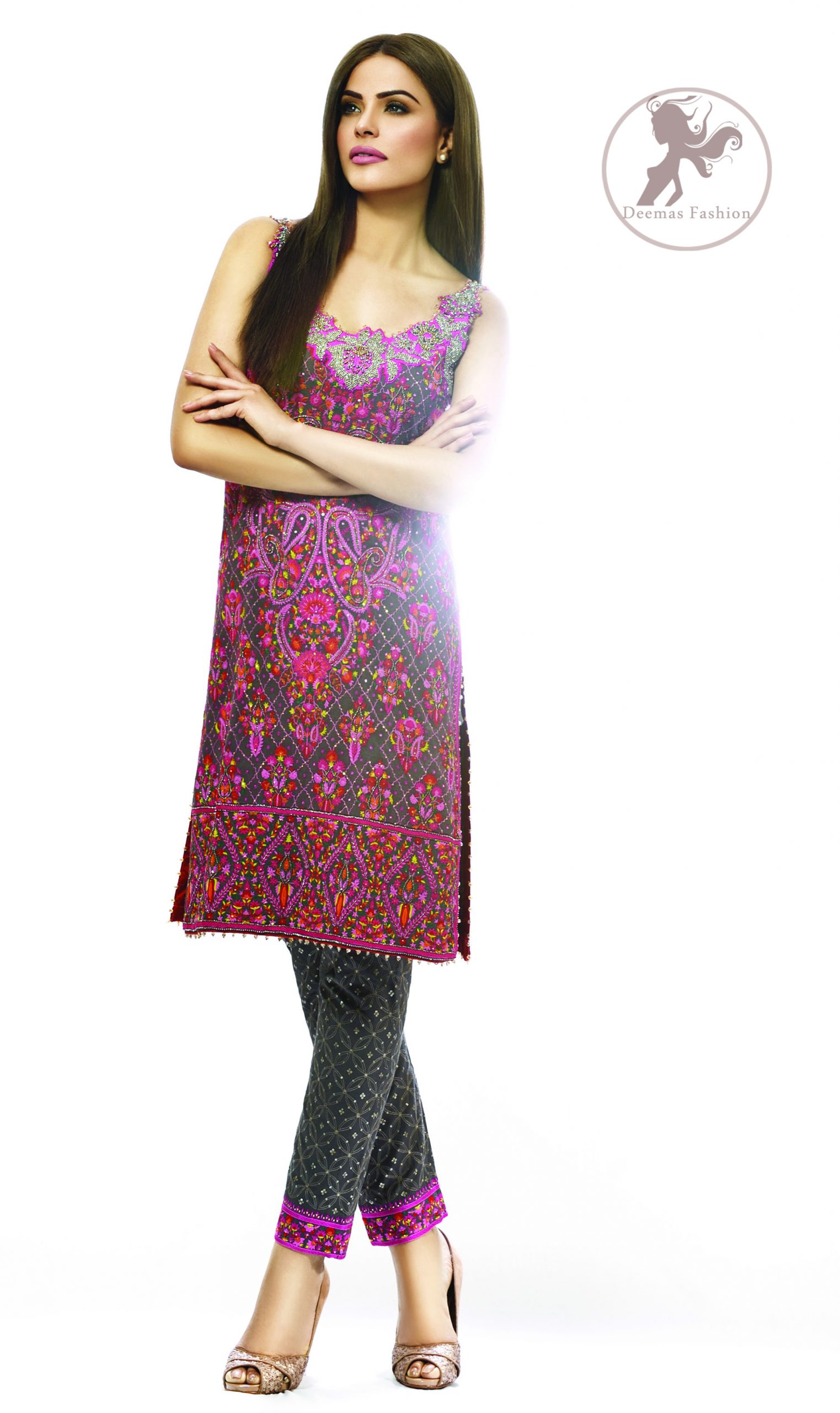 This dress is beautifully sculptured with floral embroidery, adorned with crisscross pattern, colorful embellishments and zerdozi work. The detailed geometric border gives a perfect ending to this shirt. Having sleeveless sleeves and small sprinkled motifs on shirt. Paired up with cigarette pants which is designed in crisscross pattern. It comprises with magenta chiffon dupatta.