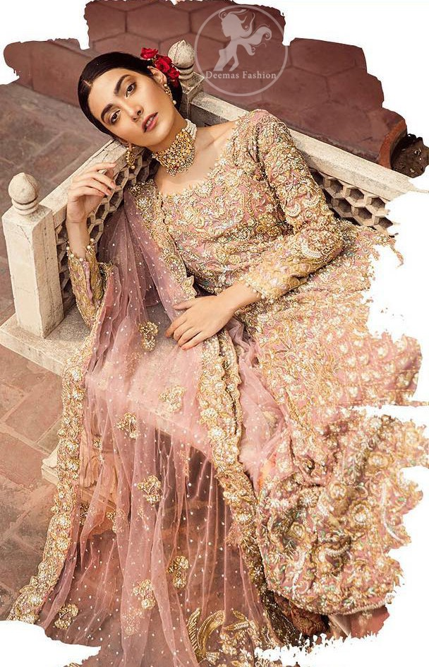 The grand gold bridal stands out due to its uniqueness and the perfect fusion of modern cut and traditional embroidery. It is highlighted with dull golden and silver kora, dabka, tilla, sequins and pearls. The frock is fully embellished from daman. It is coordinated with matching lehenga which has sprinkled floral motifs. This outfit is paired up with net dupatta which is sprinkled with sequins and small floral motifs. It is furthermore enhanced with four sided scalloped border.