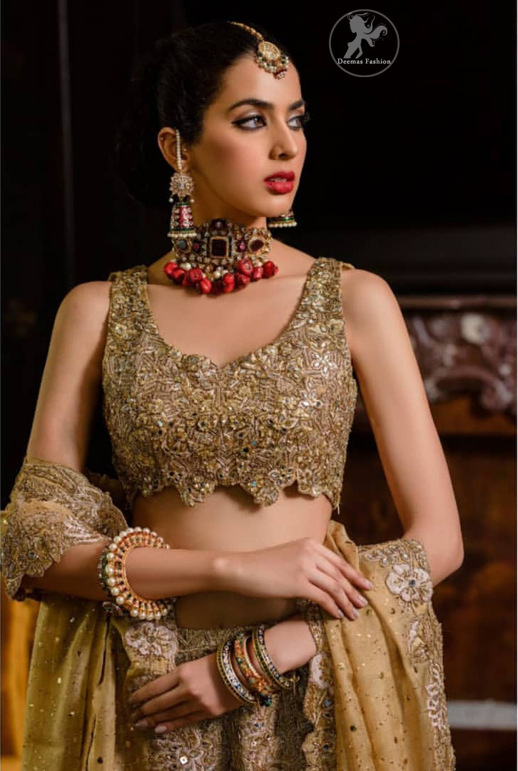 This bridal dress is perfect for your special day. Blouse is beautifully decorated with floral embroidery and embellished scalloped border. It is adorned with kora, dabka, tilla, sequins and pearls. It comes with an exquisite lehengha with thick embroidered border to give it a regal look. Dupatta comprises of floral thread embroidery allured with thick embellished border