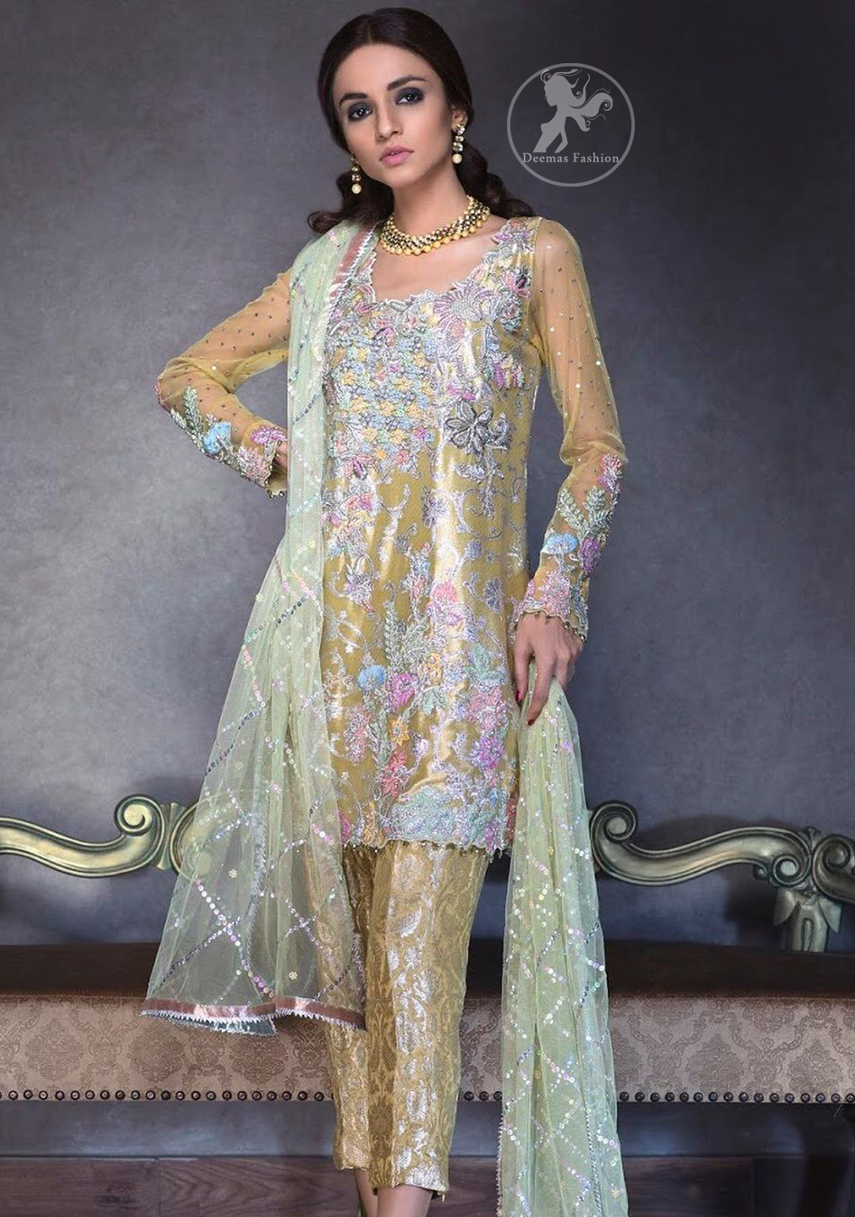 This super stunning shirt is made of rich floral embroidery which is further enhanced with colorful gota work. It is highlighted with gota work, sequins and pearls. The detailed scalloped border gives a perfect ending to this shirt. It comes with indian khaki trouser. It is coordinated with chiffon dupatta which is sprinkled with sequins all over it.