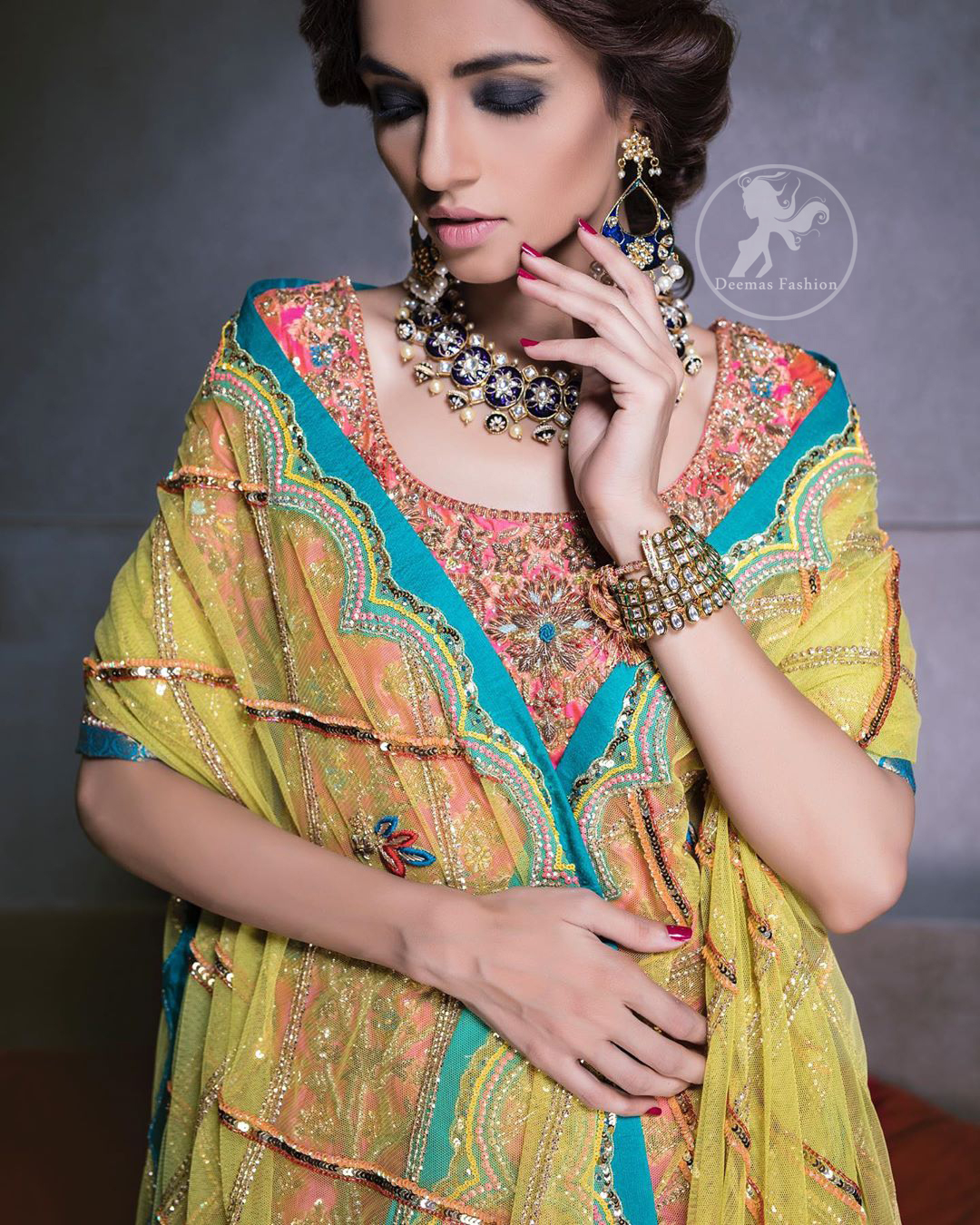 Our tea rose shirt with exquisite embellished neckline and back neckline in kora, dabka sequins and intricate thread work. The daaman is emphasized on intricate floral details that gives perfect ending to this shirt. It is coordinated with farshy gharara decorated with embroidery. The gradient turmeric dupatta has crisscross pattern and floral motifs scattered. It is finished with jamawar piping all around the edges.