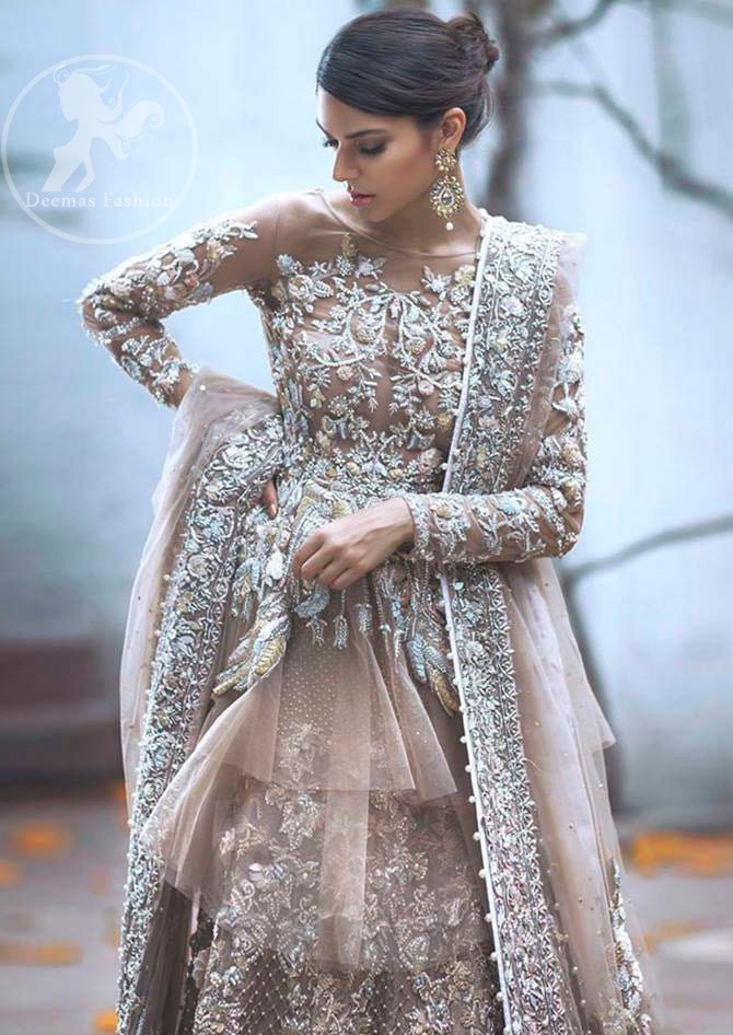 Bring out your beauty with this traditional yet modern zardosi embroidered frilled frock decorated with embellished floral motif and swarovski. It has full length floral embroidered sleeves. This outfit comes with heavy embellished lehenga which is enhanced with silver kora, dabka work and sprinkled sequins all over it. It is coordinated with beautiful dupatta with thick matha patti border on the front and intricate beautiful border on all rest of the three sides.