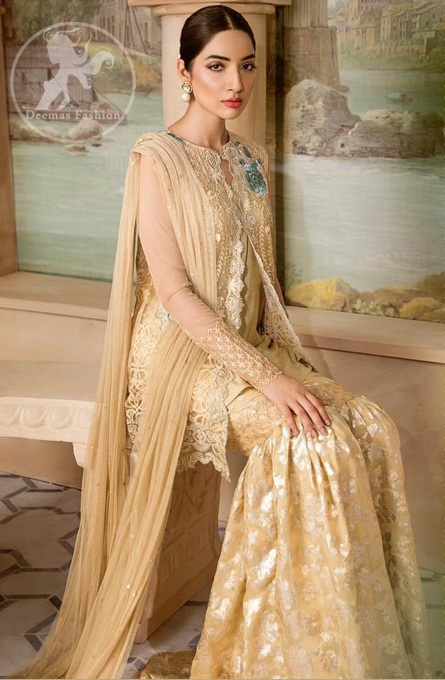 Boost your confidence and style in this glamorous attire accentuated with finest thread work embroidery and cut work hemline. This open shirt having full length sleeves and decorated with embroidery at the end. It comes with brocade gharara. It is coordinated with tissue dupatta which is sprinkled with sequins all over it.