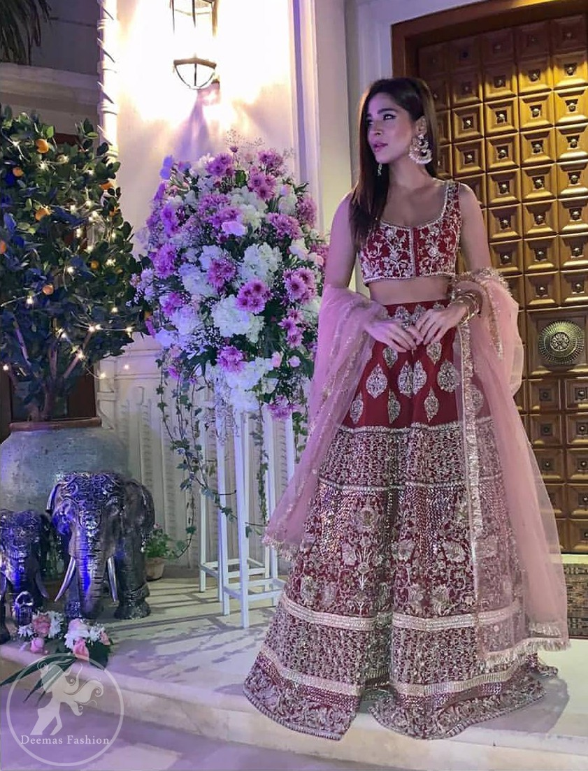 Steal the moment with our sepia brown blouse skirt emphasized with traditional embroidery and intricate floral embellishment enhanced with gold kora, dabka and sequins. It comes with heavy embellished lehenga which emphasized with different motifs and floral embroidery. It is coordinated with tissue dupatta which is sprinkled with sequins all over it.