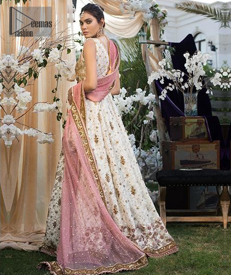This dress is majestic beauty and perfect for your engagement or evening ensemble. Delicately crafted and personifying chic elegance with an element of grandiose. This floor length maxi is decorated with intricate thread and kora, dabka embroidery on bodice and floral motifs details all over the front on ivory canvas. The bottom of the maxi is enhanced with embellished applique. It comprises with churidar pajama. It comes with net dupatta with embellished border at all ends. Style it up with embroidered waist belt.