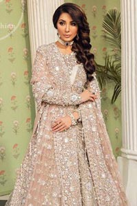 This outfit is a timeless beauty. Exude elegance and class in this full embroidered chiffon frock with zardosi work details and rich hemline. It is adorned with heavily embellished neckline and fixed waist belt. It comes with beautiful lehenga enhanced with thick embellished bottom to gives it a regal look.  This outfit is coordinated with net dupatta sprinkled with floral motifs all over it. The dupatta incorporates beautifully designed borders on all four sides, focusing on the heavily embellished pallu borders to give it a perfect look.