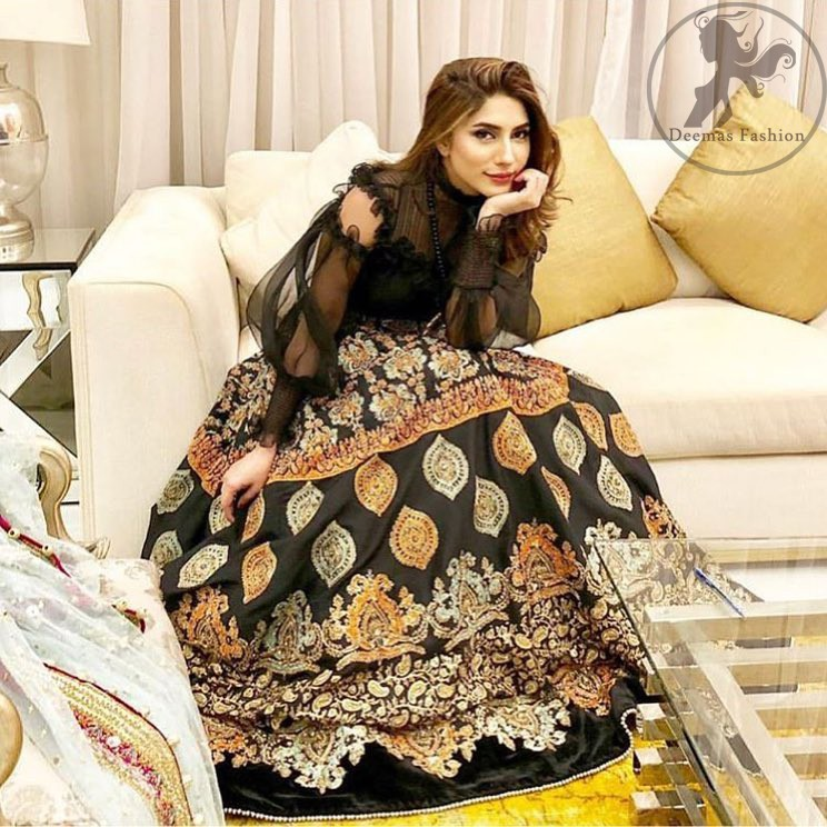 This dress is perfect for a day to evening wear. Exude elegance and class in this pishwas finessed with beautiful resham embellished daaman with floral details. It is highlighted with multiple motifs done with kora, dabka, tilla, sequins and pearls. The daman of the pishwas is adorned with black velvet having danging balls at the end. It is coordinated with tissue dupatta which is sprinkled with sequins all over it.