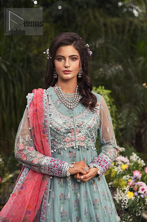 Gussy up in this luxuriously designed pishwas emboldened with intricate embroidery along with beautiful rich patterns and delicate details at the daaman. The front open jacket executing heavily hand crafted art of zardosi, kora and dabka with splashes of silver and pink floral motifs is a classical visit to feminine personification. Having full length sleeves adorned with floral bootis and lace details. It comprises with matching churidar pajama. Style it with self printed net dupatta having four sided thin border and dangling balls on all four sides.