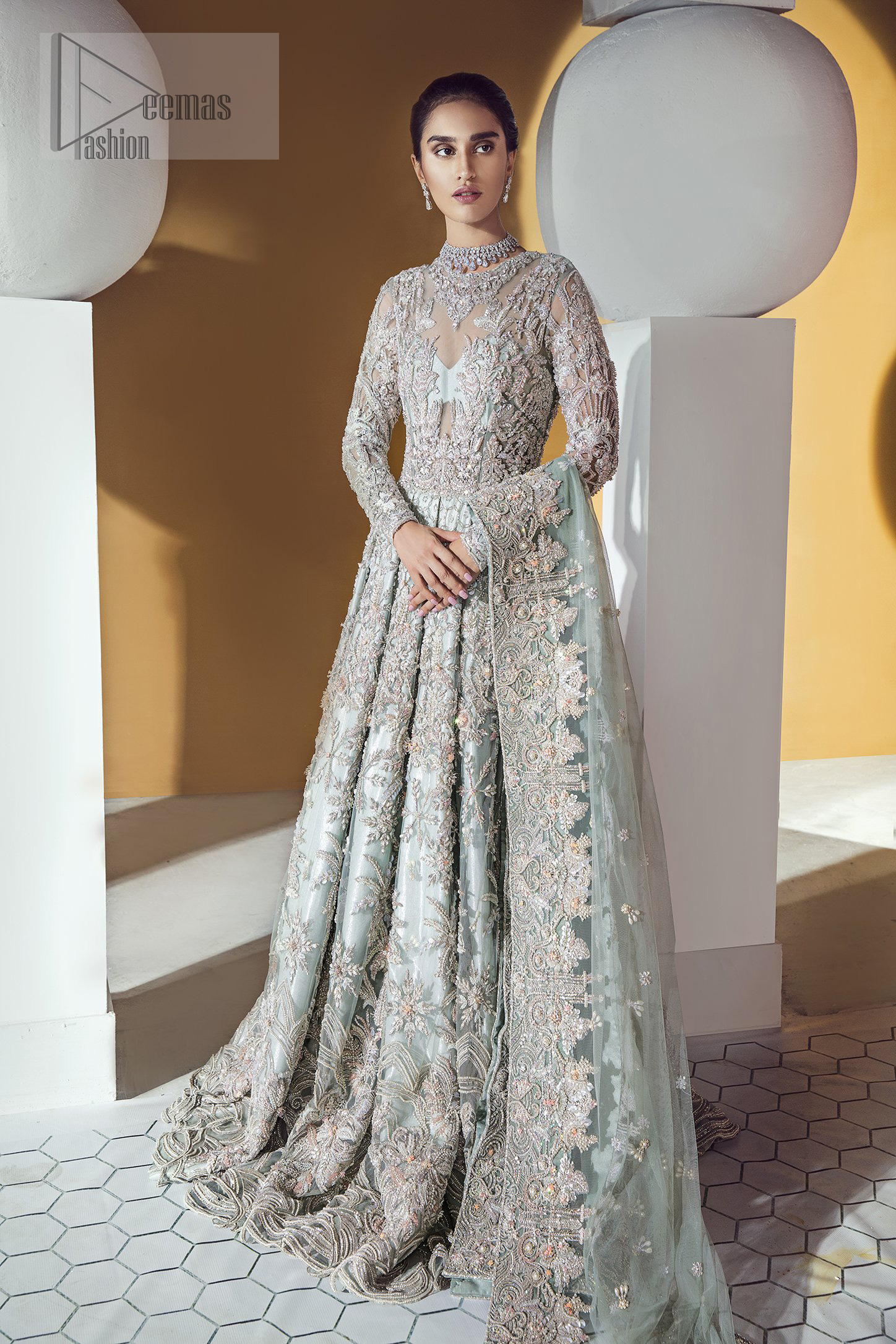 Furthermore this shirt is made of rich floral embroidery which is enhanced with zardoze work. It is highlighted with kora, dabka, tilla, sequins and pearls. It comes with brocade churidar pajama. It is coordinated with tissue dupatta which is sprinkled with sequins all over it.
