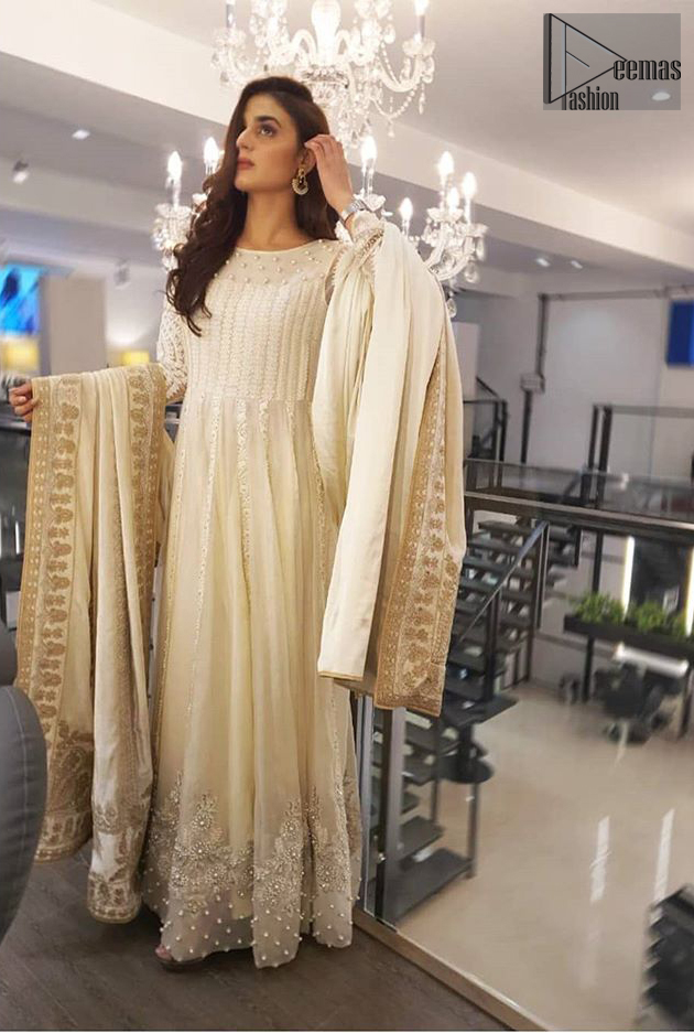 This outfit is perfect for nikah day. Exude elegance and class in this anarkali frock finessed with beautiful embellished bodice with matching thread embroidery and pearls. This trendy outfit is enhanced with thick borders and floral bunches refined the classical royal look. Having full length sleeves adorned with floral motifs. It comprises with churidar pajama. The dupatta incorporates beautifully designed borders on all four sides, focusing on the heavily embellished pallu borders to give it a perfect look.