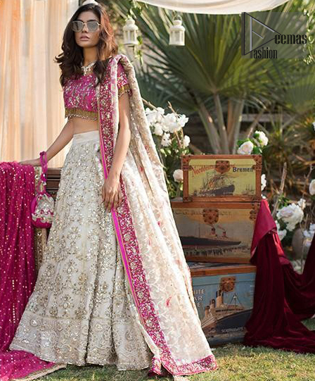 This dress id perfect for Reception or Nikah day. The bridal stands out due to its uniqueness and the perfect fusion of modern cut and traditional embroidery. Make your big day more interesting with this shabby chic statement intensified with rich zardosi work all over the front and bold patterns at daaman. The blouse is fully embellished with champagne and antique shaded embroidery all over and finishing with tassels. The outfit is beautifully coordinated with self printed dupatta adorned with shocking pink embellished applique on all four sides.