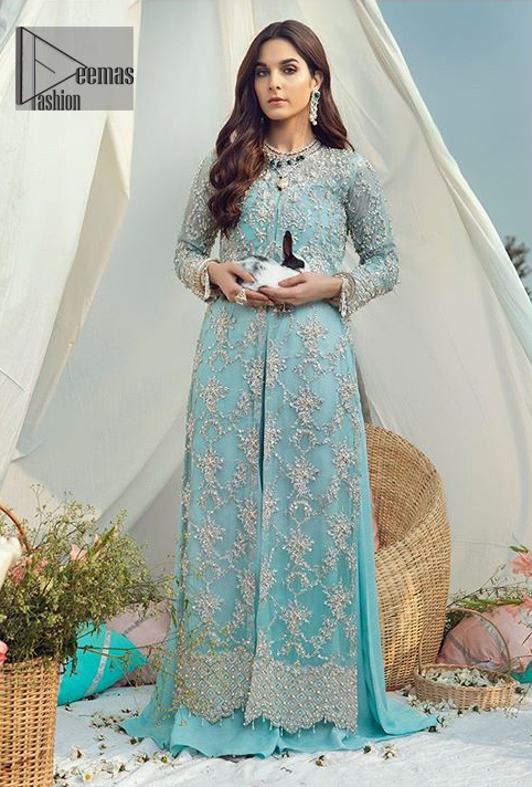 The perfect combination of tradition and class for your walima. This heavenly handcrafted front open style bridal showcases the traditional art of zardozi, nakshi, kora, dabka, sequins and beads, adorning the intricate and meticulous hand embellishments giving it a wholesome gentle stance paired with sharara. The bottom of the shirt is enhanced with thick scalloped border and finishing with tassels. Having full length sleeves adorned with sequins and and embellished floral bootis. The outfit is beautifully coordinated with matching dupatta with scalloped borders on all sides and sequins spray all over.