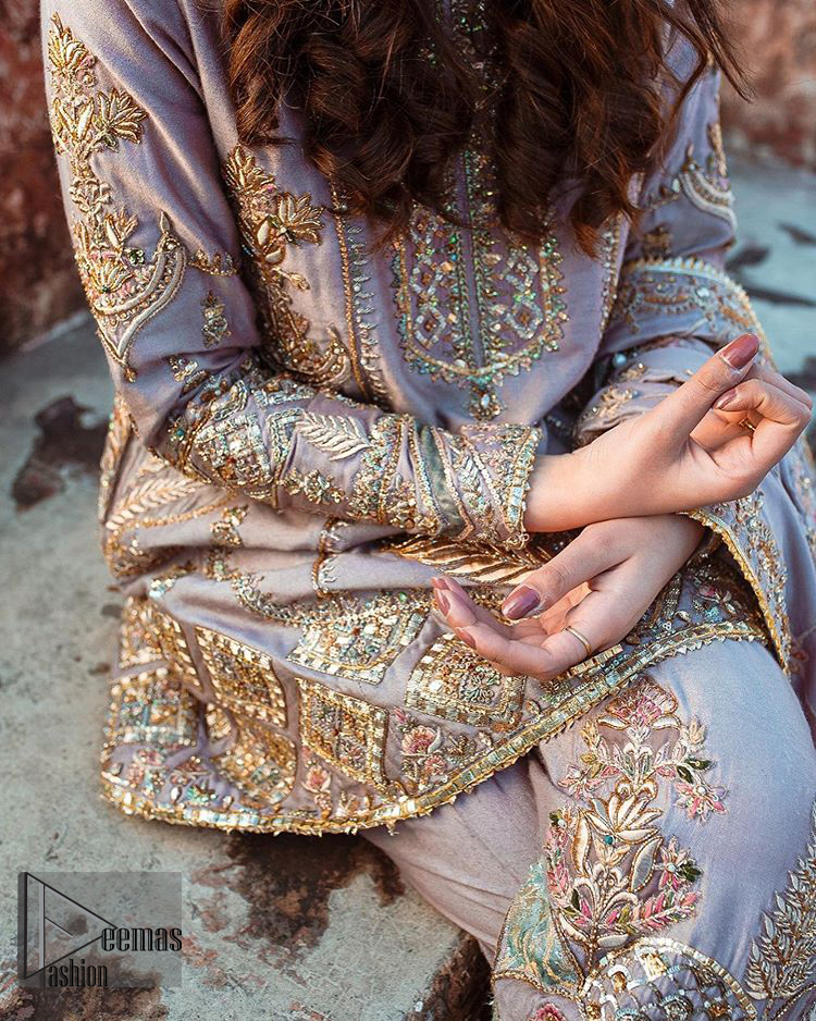 This dress is perfect for your Nikah and Engagement function. This super stunning frock is made of rich floral embroidery and geometric patterns which is further enhanced with gota work. Having full length sleeves adorned with motifs. Multiple color thread embroidery gives it a classical look. It comprises with cigarette pants ornamented with gota work and thread embroidery details. Style it confidently with raw silk fully embroidered dupatta adorned with geometric patterns and also having four sided border.