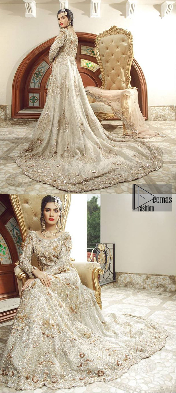 Bring out your beauty with this back trail maxi perfect for your big day. This bridal dress is beautifully sculptured with floral embroidery, adorned with cutwork borders embellished with silver kora, dabka, pearl and sequins work all over. The detailed resham and tilla work on the back of maxi and multiple floral motifs ornamented with gold kora and dabka embroidery on the bodice, the thick borders and floral bunches refined the classical royal look. Furthermore full length sleeves heavily embellished with zardosi work. It comprises with churidar pajama.