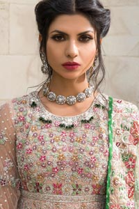 Opt for our ivory or peach multiple-panel frock dress with exquisite embellishment on the bodice with pearls, sequins and silver kora, dabka. The daaman comprises of borders highlighted with floral embellished pattern. It is finished with deep blush frilled lehenga which adds to the bling. Dupatta is allured with four sided embellished border and sprinkled with stones all over it.
