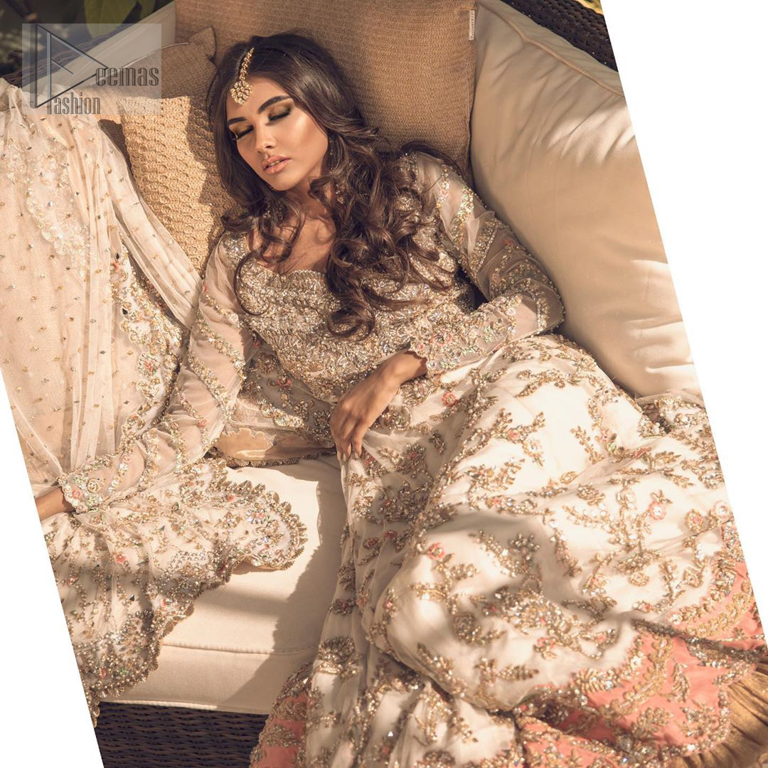 Reflecting exuberant color play in this ethereal piece meticulously highlighted with antique shaded kora, dabka, tilla and sequins. The frock is delicately crafted with floral bunches, fully embellished bodice and scalloped applique daman to give it a perfect ending. The contemporary yet traditional embroidered stripes on the sleeves completes the look. The outfit is comprises with mustard crushed sharara. It is paired with ivory chiffon dupatta with sequins chann all over and two sided embroiderd pallu.