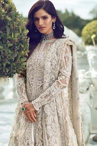 Captured in traditional silhouette, The bridal stands out due to its uniqueness and the perfect fusion of modern cut and traditional embroidery. It is highlighted with silver and light golden kora, dabka, tilla, sequins and pearls. It comes with heavily embellished front open back trail gown ornamented with floral embroidered motifs and geometric patterns. Paired up with ivory lehenga done with light gold embroidery. It is coordinated with chiffon dupatta which is sprinkled with sequins all over it. It is further furnished with four sided border.