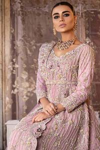 Exude elegance and class in this back trail maxi finessed with beautiful embellishment. The outfit is beautifully sculptured with floral embroidery, adorned with vertical lines and fixed waist belt embellished with silver and light golden kora, dabka, tilla and sequins work all over. The back of the outfit has an artistically designed motif. The outfit is styled with a hand embellished crystal belt. It comprises with cigarette pants and light pink net dupatta ornamented with sprinkled sequins on the ground and four sided light border.