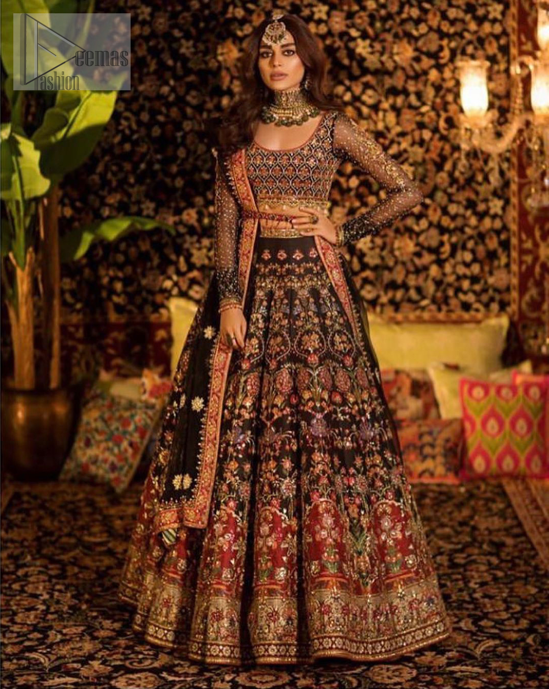Tradition meets modernity. Go glam in our black traditional lehenga blouse. This outfit bursts of vibrant colors and sumptuous details of zardozi, gota, kora and dabka is a perfect Mehndi ensemble. It is aesthetically designed with thick borders and floral bunches refined the classical royal look. Blouse is decorated with geometric patterns having full sleeves adorned with zardosi work and sprinkled sequins. Style it up with black net dupatta sprinkled with tiny floral motifs and four sided applique embellishment. The piece comes with a handcrafted belt.