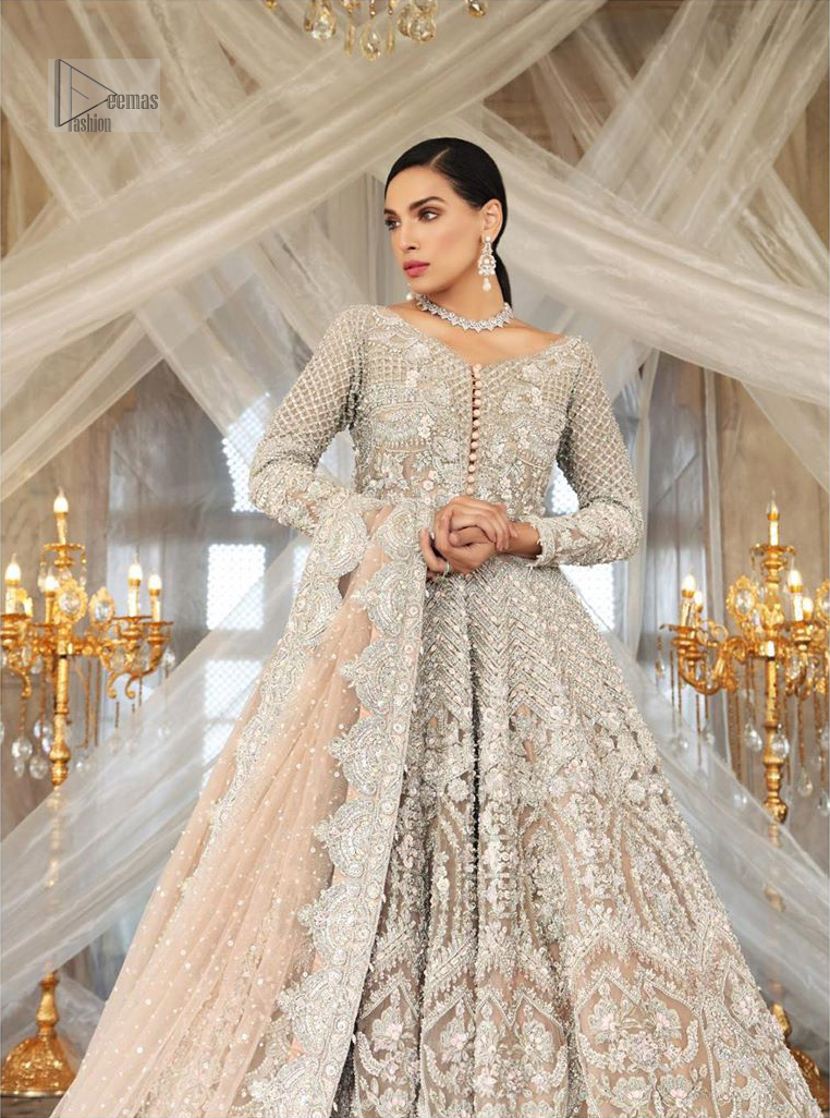 Paint a picture of pure elegance with this beautiful pishwas. This dress is beautifully sculptured with floral embroidery, adorned with geometric patterns embellished with silver kora, dabka, pearls and sequins work all over. The detailed scallop border gives a perfect ending to this pishwas. The lehenga is emphasized with embellished bottom that gives perfect ending to thisoutfit. It is coordinated with net dupatta sprinkled with chann all over and finished with embroidered border on four sides which makes this outfit more beautiful.