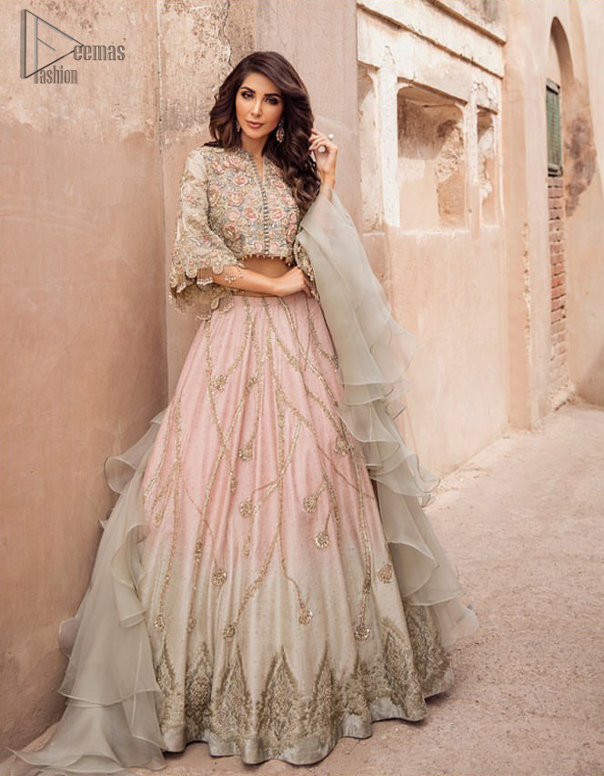 This artisanal piece is rendered in grace and timelessness. An example of beauty and elegance. Look breathtakingly stylish in this embroidered regalia furnished with intricate embroidered blouse and scalp third quarter bell sleeves. It comprises with gradient lehenga having light pink and mint green colors done with zardozi floral bootis and a thick embellished bottom. Style it up with mint green organza dupatta.