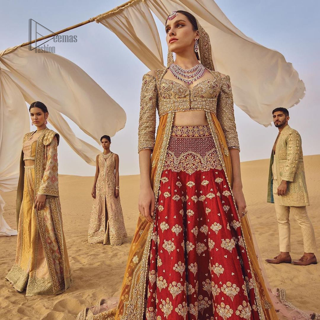 This weeding outfit makes a statement in this stunningly floraison, perfect blend of glamour and tradition with outstanding craftsmanship and gorgeous detailing. Heavily embellished blouse and bottom done with golden zardozi work and detailed central slits instantly draws attention. The lehnga with embroidered motifs spread all over and thick embellishment on lower waist. Paired it up with light pink net dupatta sprinkled with tiny motifs and four sided border.