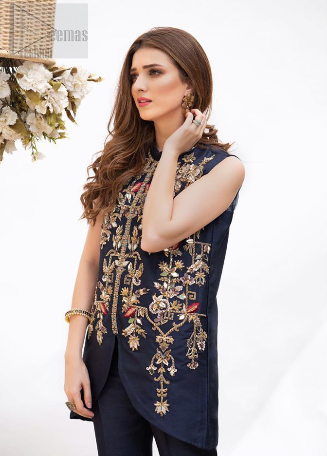 This outfit is timeless beauty. Boost your confidence and style in this glamorous attire accentuated with finest zardozi and thread work. The shirt is delicately handcrafted with golden zarozi work and multiple color thread embroidery. Style it up with navy blue bell bottom pants which complete the look.