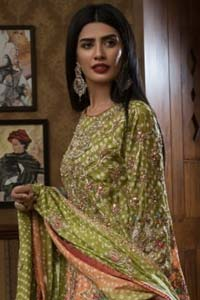 Brighten up your look with this beautiful mehndi dress comes with a beautiful parrot green shirt. This shirt is adorned with light gold kora, dabka, tilla and sequins work, furthermore the hemline is enhanced with applique embellishment. Paired it up with traditional jamawar gharara ornamented with zardozi work and finished with lace embellished border. It is coordinated with parrot green dupatta dyed from pallu in two colors and adorned with applique embellished border.