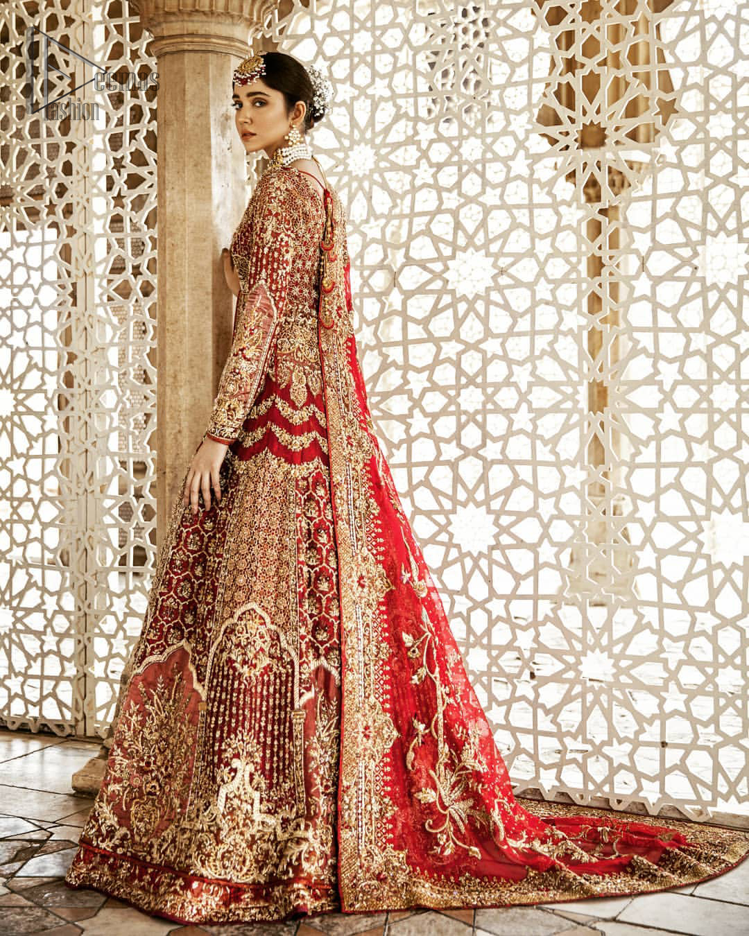 Captured in traditional silhouette, This traditional red pishwas is aesthetically designed with motifs,geometric and floral patterns, embellished with kora, dabka, tilla and sequins work. It comes with full embellished lehenga which is gorgeously handcrafted with golden and antique shaded zardozi work. The piece comes with a handcrafted belt. It is coordinated with net dupatta which is sprinkled with sequins all over it. It is further furnished with four sided border and floral bunches.