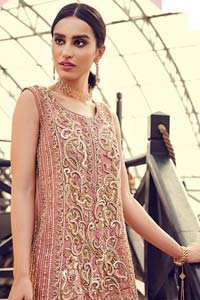 Delicately crafted and personifying chic elegance with an element of grandiose. You are all set to make a lasting impact with the divine royalty of this dress. The outfit is perfected with loaded dull golden, golden and antique work. The shirt is delicately hand crafted using the finest old age techniques and materials including kora, dabka, tilla, sequins and pearls. The back of the shirt is highlighted with cutwork embellishment. Furthermore it is also enhanced with thread embroidery. This outfit is comprises with peach raw silk bell bottom. Complete the look with peach organza dupatta decorated with sequins spray all over.