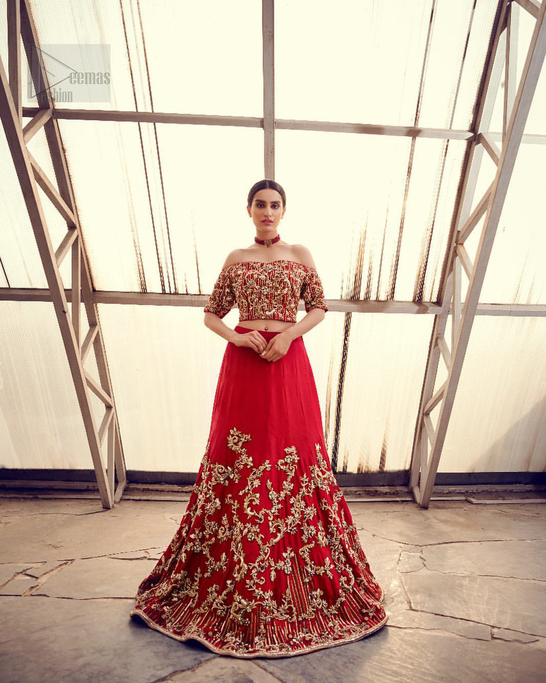 Captured in traditional silhouette, The bridal stands out due to its uniqueness and the perfect fusion of modern cut and traditional embroidery. This dress is beautifully decorated with heavy embroidery. It is highlighted with kora, dabka, tilla, sequins and pearls. Off shoulder blouse is enhanced with zardosi work all over. It comes with full embellished lehenga adorned with floral booties and vertical lines all over it. It is coordinated with net dupatta which is sprinkled with sequins all over it. It is further furnished with four sided embellished border.
