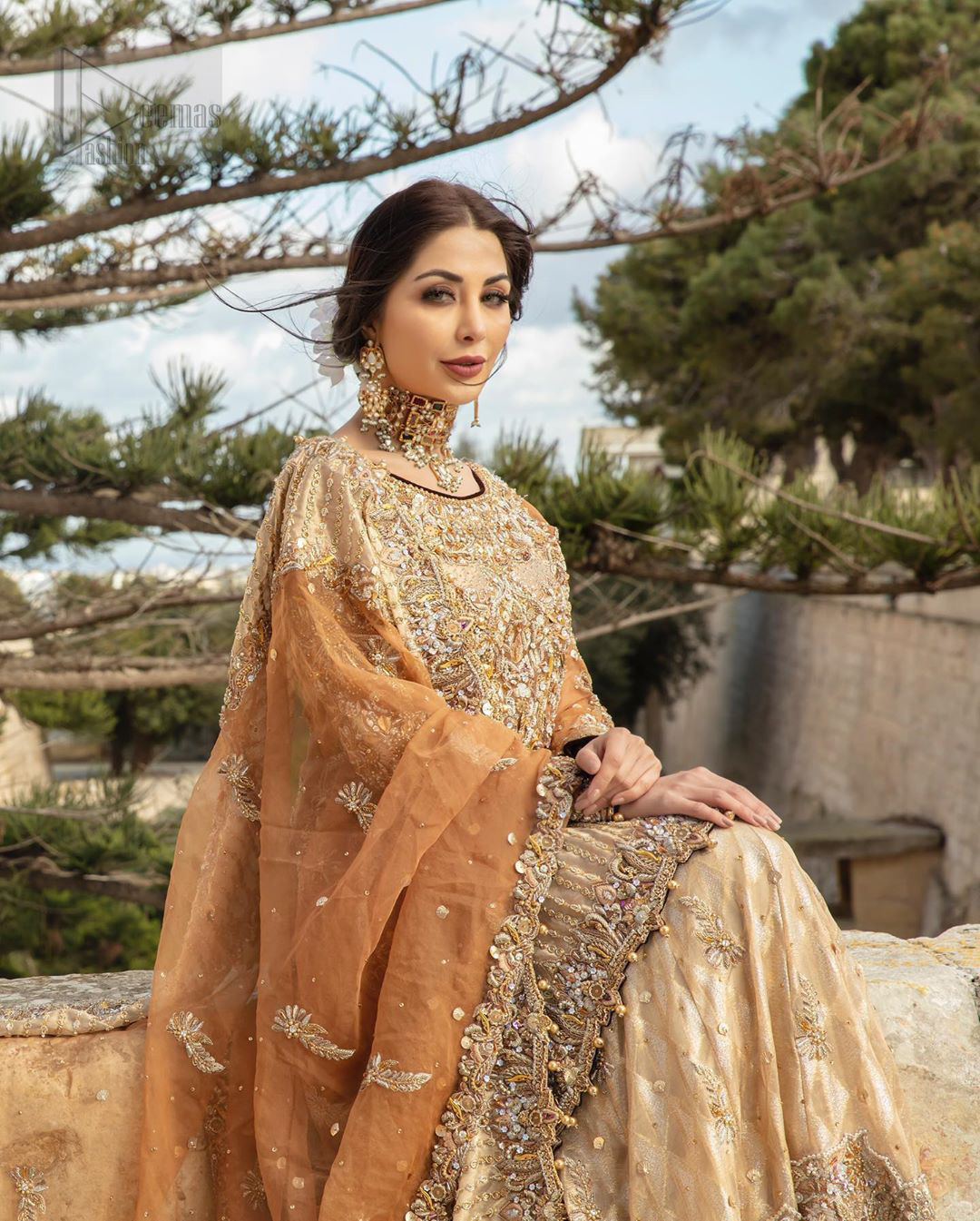 Dazzle in this made to perfection, richly embroidered ensemble accentuated with floral motifs and finished with scalp borders. Excellence of craftsmanship is evident with intricate detailing that features the use of kora, dabka, crystals, sequins and pearls. The Scalloped hemline is emphasided with dangling pearls. Balance the look with light golden lehenga adorned with golden, silver and antique shaded zardozi work. Dupatta comes with embellished alluring cut work floral border gives the perfect ending to this peplum.