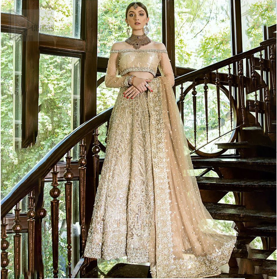This outfit brings drama and playfulness to traditional lehenga blouse with a modern approach. Classic balanced pattern on the lehenga of tissue fabric adds exquisiteness to the look. The selection of color much of a choice for the festive season. The off shoulder blouse make a statement with light golden zardozi work. Complete the look with golden dupatta heavily embellished from all four sides and sprinkled with sequins all over.