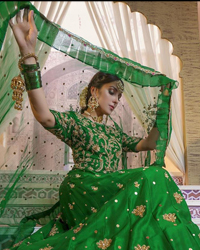 Nothing speaks of femininity and class louder than this green mehndi outfits for bridesmaids. This beautiful outfit comes with a green lehenga which is beautifully embellished with motifs, sprinkled with sequins and it finished with a thick embellished border. The blouse is breathtakingly ornamented with floral bootis which covers every inch of the blouse. The dupatta incorporates beautifully designed scalloped borders and frilled on all four sides. The kora, dabka, tilla, sequins and pearls work are done in the shades of golden.