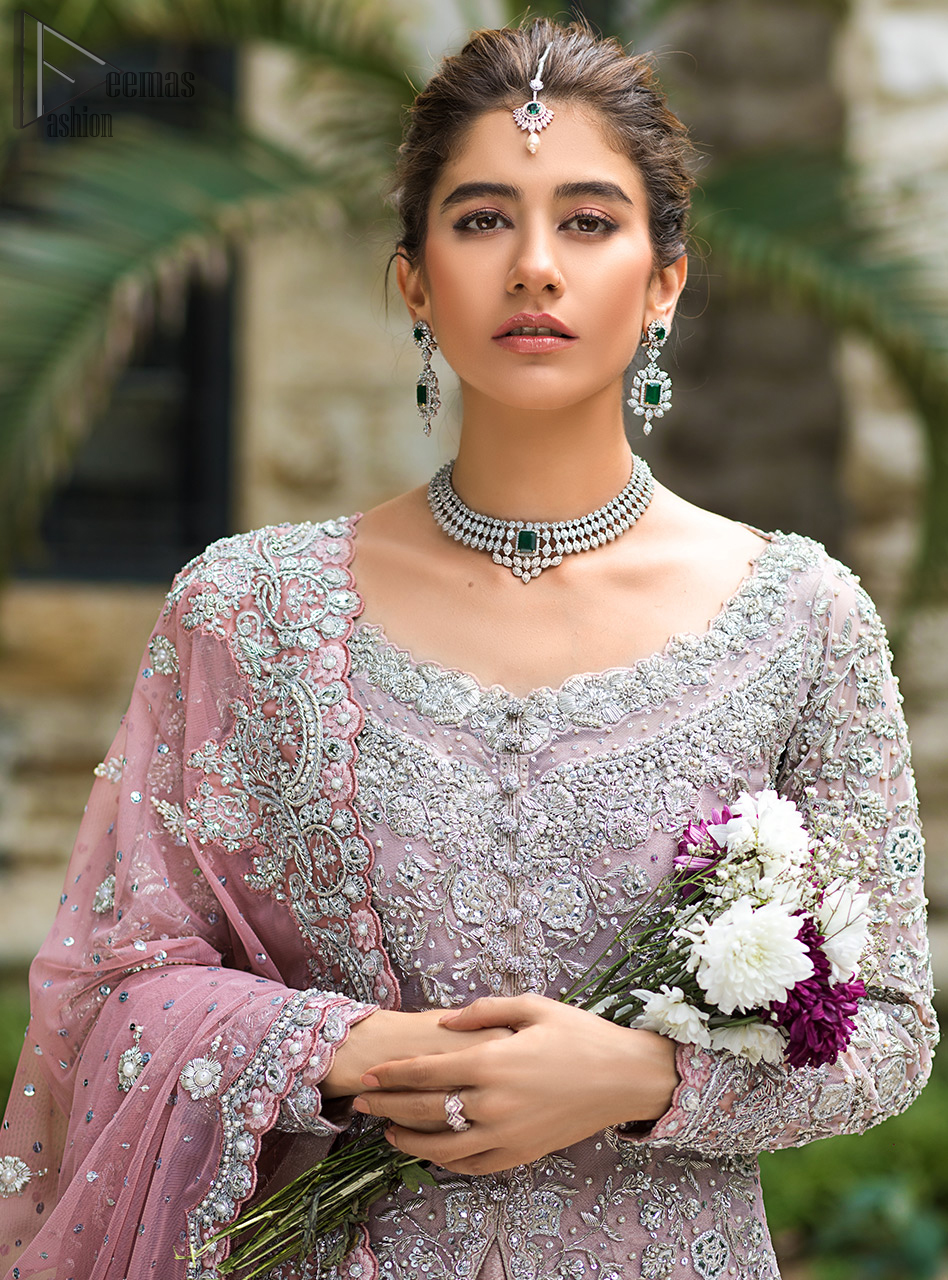 Pink Front Open Gown - Ruffled Sharara - The gown is beautifully sculptured with floral embroidery, adorned with intricately embellished borders with silver kora, Dabka, pearl and sequins work all over.